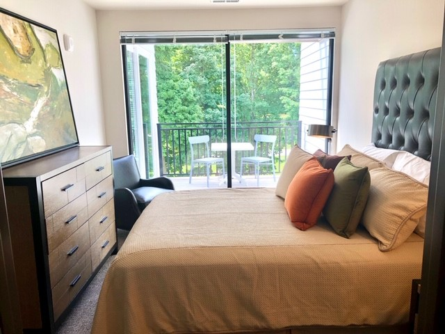 Gallatin Bedroom and Slide Door to Balcony